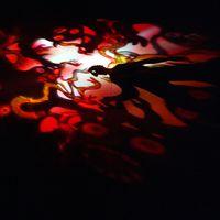 <em>L'uccello di fuoco</em> (1994, 2004), based on music by Igor Stravinsky and figures by Enrico Baj, with shadows and dance, a co-production of Teatro Gioco Vita (Piacenza, Italy) and Fondazione Nazionale della Danza (Reggio Emilia, Italy), direction and scenography: Fabrizio Montecchi, choreography: Mauro Bigonzetti, Giuseppe Calanni, costumes: Giulia Bonaldi, Anusc Castiglioni, music consulting: Michele Fedrigotti, scenic construction, artwork and prop-making: Nicoletta Garioni, Gaia Barboni, Paola Camerone, Federica Ferrari, lights and soundtrack: Cesare Lavezzoli, dancers: Anna Basti, Alfonso De Giorgi, Margherita Pirotto. Photo courtesy of Teatro Gioco Vita. Photo: Massimo Bersani