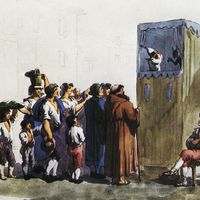 A coloured print from the period depicting Ghetanaccio's puppet booth set up in a street (probably the Piazza di Pasquino), Ghetanaccio's puppets, a musician, and the audience. Collezione Maria Signorelli