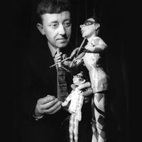 Eric Bramall of Eric Bramall Marionettes and founder of the first permanent puppet theatre in Great Britain, the Harlequin Puppet Theatre (Colwyn Bay, North Wales) with two of his harlequin string puppets. In cabaret, the larger marionette operated the smaller. Photo courtesy of Michael Dixon and Christopher Somerville