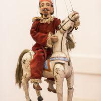 The comic Czech character Kašpárek on Horse. String puppet made of wood and fabric, 19th century, height: 38 cm, design: Mikoláš Sychrovský. Collection: Jiří Vorel (Czech Republic). Photo: Vojtěch Brtnický