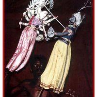 Goddess Durga battles and eventually slays the water buffalo demon, in <em>Mahishasura Mardini</em>, traditional rod puppetry, <em>kathi kundhei</em> na<em>c</em>ha, of <em>Or</em>issa (Odisha), India. Photo courtesy of Sampa Ghosh