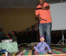Puppeteer with a string puppet from the puppet theatre group, Coopérative Masrah Arous Wahran (<em>Or</em>an [Arabi<em>c</em>: <em>Wahrān</em>], Algeria). Photo: Houari Abdelkhalek