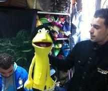 Puppeteers with a muppet-style glove puppet from the puppet theatre group, Coopérative Masrah Arous Wahran (<em>Or</em>an [Arabi<em>c</em>: <em>Wahrān</em>], Algeria). Photo: Houari Abdelkhalek