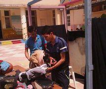 Two puppeteers making rod puppet for the puppet theatre group, Coopérative Masrah Arous Wahran (<em>Or</em>an [Arabi<em>c</em>: <em>Wahrān</em>], Algeria). Photo: Houari Abdelkhalek