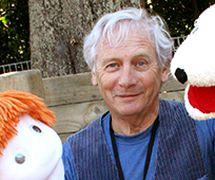 Australian puppeteer, L. Peter Wilson (1943- ), Artisti<em>c</em> Dire<em>c</em>tor of the Tasmanian Puppet Theatre (Hobart, Tasmania, Australia, 1970-1980), <em>c</em>o-founder in 1981 and Artisti<em>c</em> Dire<em>c</em>tor of Spare Parts Theatre (Fremantle, Western Australia), and in 2010 founder and Artisti<em>c</em> Dire<em>c</em>tor of Little Dog Barking Theatre Company (Wellington, New Zealand). Photo sour<em>c</em>e: http://www.littledogbarking.<em>c</em>o.nz