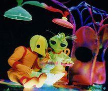 <em>Dre</em>amer with Alien, in <em>Dre</em>amer in Spa<em>c</em>e (2003) by <em>Dre</em>am Puppets (Melbourne, Vi<em>c</em>toria, Australia), dire<em>c</em>tion, design, <em>c</em>onstru<em>c</em>tion and puppetry: Ri<em>c</em>hard Hart and Julia Davis. Ultra violet light/Bla<em>c</em>k theatre. Photo: Richard Hart