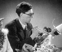 Boris Tuzlukov (1909-1974), Russian puppet theatre and stage designer, at work with puppets for Korol Olen (The <em>Ki</em>ng Stag, 1943) by Carlo Gozzi, production of Gosudarstvenny tsentralny teatr kukol (Sergei Obraztsov Central Puppet Theatre, Moscow, Russia). Photo courtesy of Collection: Gosudarstvenny akademichesky tsentralny teatr kukol imeni S.V. Obraztsova, Puppetry Museum (Moscow, Russia)