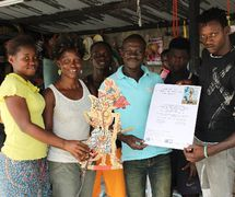 """Members of the Compagnie Ivoire Marionnettes (Abatta, Abidjan, Côte d'Ivoire), receiving the prize """"Marionnettes for Peace"""", (left to right): Kouassi Desirée, Goualy Rachelle, Sorho Yacouba, Soro Badrissa (director), Cissé Adama, and Koro Souleymane. Photo courtesy of Soro Badrissa"""