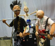 <em>Clobber</em> (2003). Punk marionette band created and performed by American puppet director, designer, builder and puppeteer Jason Hines, initially created for the Center for Puppetry Arts' Xperimental Puppetry Theater program (Atlanta, GA, United States). Photo courtesy of Center for Puppetry Arts. Photo: Lee Randall