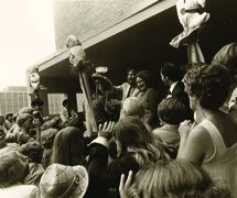 Jim Henson and Kermit the Frog cut the ribbon during the opening ceremony of the Center for Puppetry Arts in 1978 (Atlanta, GA, United States). Also featured in photo: Jane Henson. Photo courtesy of Center for Puppetry Arts