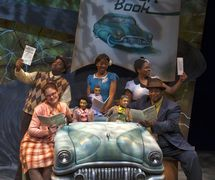 <em>Ruth and the Green Book</em> (2012) by Center for Puppetry Arts (Atlanta, GA, United States). Based on the book by Calvin Ramsey with illustrations by Floyd Cooper, adaptation and direction: Jon Ludwig, composer: S. Renee Clark, puppet design: Jason Hines, scenic design: Kat Conley, lighting design: Liz Lee, projections: Travis Overstreet, Wes Parham and Mike Post, costume design: Erik R. Teague, puppet costumer: Scottie Rowell, sound design: Gregory Montague, choreographer: Ricardo Aponte. Performers featured in photo: Amy Sweeney, David Koté, Tara Lake, S. Renee Clark, Spencer Stephens. Photo: Clay Walker