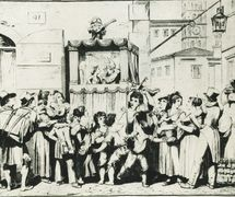 An 1830 engraving by Italian illustrator and engraver Bartolomeo Pinelli (1781-1835) of a street puppet show performed in a <em>casotto</em> (portable booth) by Italian itinerant puppeteer Ghetanaccio (1772-1832). Collezione Maria Signorelli