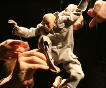 Bud the Plumber, from <em>Low Life</em> (2005) by Blind Summit (London, UK). Puppeteers featured in the photo: Curtis Jordan, Mark Down, Mhairi Steenbo<em>c</em>k. Tabletop puppetry. Photo courtesy of Blind Summit