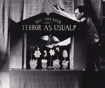 Toy <em>Theater of Terror As Usual</em> (ongoing series, currently in its 13th episode, first episode created in 1990) by Great Small Works (New York City, USA). Actor/puppeteer featured in the photo: John Bell. Toy theatre, tabletop proscenium stage. Photo: Orlando Marra