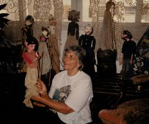 Magda Modesto with Indonesian rod puppets, <em>wayang</em> golek, from her international collection of traditional puppets. Photo courtesy of Cecilia Modesto