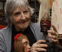 Magda Modesto with puppets from her international collection of traditional puppetry. Photo courtesy of Cecilia Modesto