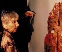 Magda Modesto with a tolu bommalata shadow figure from Andhra Pradesh, India. Photo courtesy of Cecilia Modesto