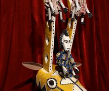 A traditional rod puppet from Bamana, Mali, representing an antelope and three human figures made of wood and cloth. Donated by Mary Decker, Northwest Puppet Center. Photo: Dmitri Carter