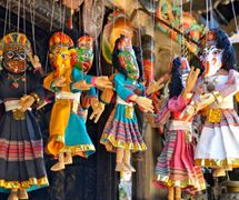 Five Nepalese string puppets, called <em>putali</em>; the four-face puppet (second from left) depicts Ganesh, Kumari, Bhairab and Durga, deities widely worshipped in Nepal and India. Photo: Carol Davis