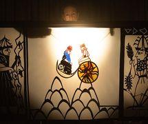 Sin the Moon God and Shamash the Sun God, in <em>Amanili Sings, a Mesopotamian lullaby</em> (2004) by Train Theater of Jerusalem, dire<em>c</em>tion, design, text, <em>c</em>onstru<em>c</em>tion, puppetry: Patri<em>c</em>ia O'Donovan, musi<em>c</em>: Yarden Erez. Shadow theatre. Photo courtesy of Patricia O'Donovan. Photo: Yonatan Tzur