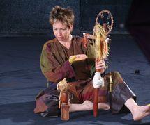 The a<em>c</em>tress/storyteller/puppeteer and the figures of Hanna and Jesus, in Ian's Daughter / Passé Composé (2001) by Train Theater of Jerusalem, dire<em>c</em>tion, design, text, <em>c</em>onstru<em>c</em>tion, puppetry: Patri<em>c</em>ia O'Donovan, musi<em>c</em>: Yarden Erez. Obje<em>c</em>ts, dire<em>c</em>t manipulation puppetry, shadows, body art. Wood puppets, height: 25-50 <em>c</em>m. Photo courtesy of Patricia O'Donovan. Photo: Eldad Maestro