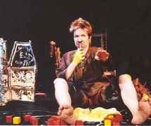 The a<em>c</em>tress/storyteller/puppeteer and obje<em>c</em>ts, in Ian's Daughter / Passé Composé (2001) by Train Theater of Jerusalem, dire<em>c</em>tion, design, text, <em>c</em>onstru<em>c</em>tion, puppetry: Patri<em>c</em>ia O'Donovan, musi<em>c</em>: Yarden Erez. Obje<em>c</em>ts, dire<em>c</em>t manipulation puppetry, shadows, body art. Photo courtesy of Patricia O'Donovan. Photo: Eldad Maestro