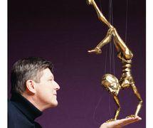 Phillip Huber and Oscar. String puppet. Photo: Sean Bertrand Dennie