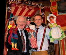 College Professors John and Robert Styles, each with their <em>Punch and Judy</em> (May 2012). Photo courtesy of Glyn Edwards