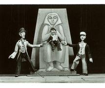 <em>?K.D.O.?</em> (1931) by Umělecká scéna Říše loutek (Prague, Czechoslovakia), direction: Vojtěch Sucharda, design: Vojtěch Sucharda (puppets), Anna Suchardová-Brichová (costumes and stage design). Photo courtesy of Archive of Umělecká scéna Říše loutek