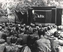 Performance for soldiers in 1942 during World War II by Sergei Obraztsov Central Puppet Theatre. Photo courtesy of Collection: Gosudarstvenny akademichesky tsentralny teatr kukol imeni S.V. Obraztsova, Puppetry Museum (Moscow, Russia)