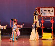 <em>A Large Puppet Writes Calligraphy</em> (大木偶书艺, 2006) by Sichuansheng Damuou Juyuan (Beiqiandao, Shunqing District, Nanchong, Sichuan Province, People's Republic of China), direction: Tang Guoliang, design/construction: Shu Shilin, Zhao Qing, Xu Xueshu, Xian Guanghui, Hu Xingying, puppeteer: Chen Gongtao. Rod puppet, height: 180-200 cm