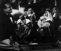 Vittorio Podrecca with puppets from the Teatro dei Piccoli production of <em>La bella addormentata nel bosco</em> (1922) composed by Ottorino Respighi based on the classic fairy tale by Charles Perrault. Collezione Maria Signorelli. Photo courtesy of Istituto per i Beni Marionettistici e il Teatro Popolare (Turin, Italy)