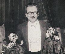 Italian director of Teatro dei Piccoli, Vittorio Podrecca (1883-1959), with two of his string puppets. Collezione Maria Signorelli. Photo courtesy of Istituto per i Beni Marionettistici e il Teatro Popolare (Turin, Italy)