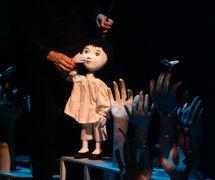 <em>Contes du temps qui passe</em> (year of creation: 1992 [GTQ]; recreation: 1993 [Théâtre de Sable]) by Théâtre de Sable (1993-2013), direction: Gérard Bibeau, scenography and puppet design: Josée Campanale, fabrication: Josée Campanale assisted by Réjean Bibeau. Puppet featured in the photo: L'enfant au lapin de lune [The Child with moon rabbit], height: 65 cm, wood, fibreglass, fabric. Collection: Musée de la civilisation, gift of Théâtre de Sable, 2012-821-42. Photo: Louise Leblanc