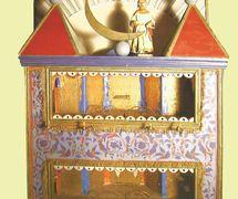 Wooden box-theatre, with <em>c</em>oloured paper de<em>c</em>oration, of a Slavutsky style vertep (1896, Slavuta, south-east of Rivne Oblast). Text, dire<em>c</em>tion, design and puppet <em>c</em>onstru<em>c</em>tion, manipulation: O. Augustinovi<em>c</em>h (who was inspired by his master, the priest Yakov Ratovsky, who performed with vertep in 1854). Colle<em>c</em>tion: State Museum of Theater, Musi<em>c</em> and Cinema of Ukraine (Kyiv). Photo: V. Varshavets